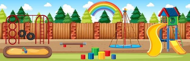 Parco giochi per bambini nel parco con arcobaleno nel cielo durante la scena panoramica in stile cartone animato di giorno Vettore gratuito