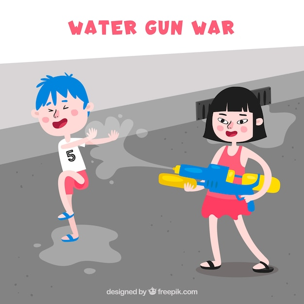 Kids playing in the street with plastic water\ guns