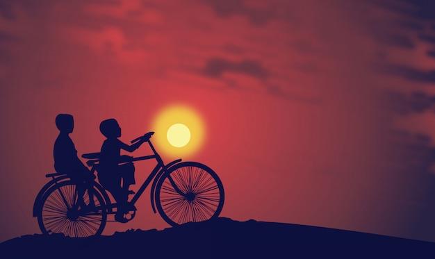 Kids riding a bike at sunset Premium Vector