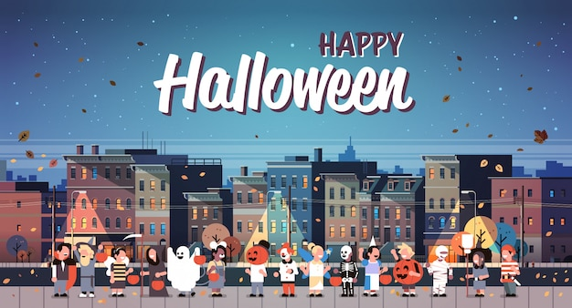 Kids wearing monsters costumes walking night town holiday banner Premium Vector