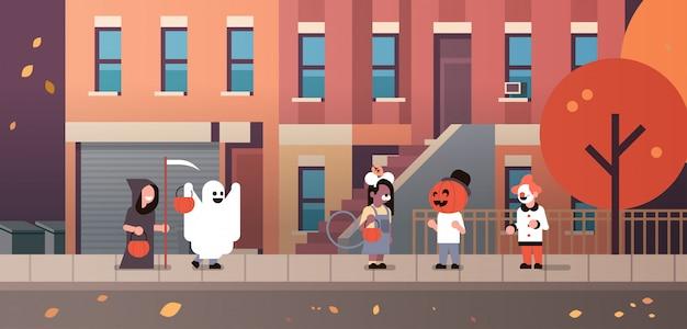 Kids wearing monsters ghost pumpkin wizard clown costumes walking town banner Premium Vector
