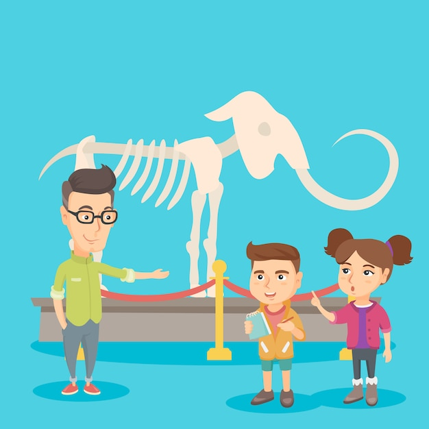 Kids with a teacher studying a skeleton in museum. Premium Vector
