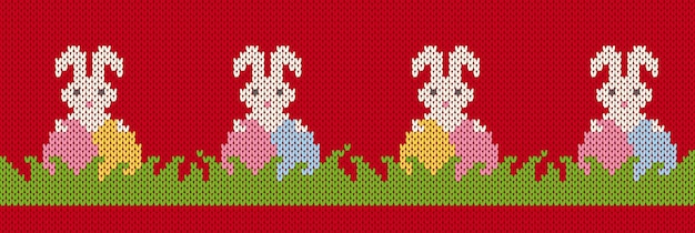 Knit seamles pattern with easter bunnies and eggs in grass. happy easter red background with rabbits Premium Vector