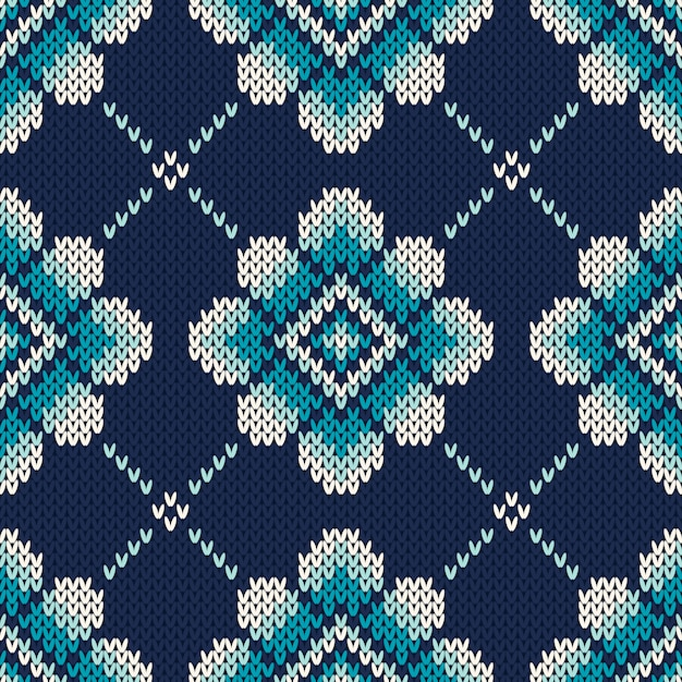 Knitted pattern with flowers. seamless sweater design Premium Vector