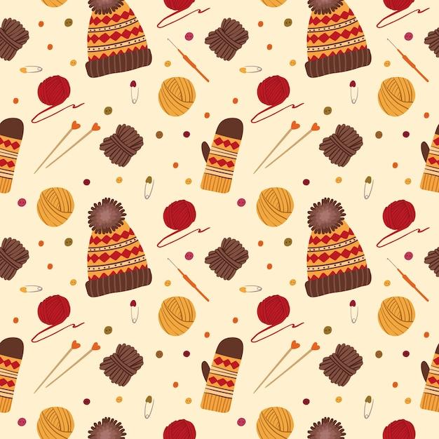 編み物の帽子と手袋のシームレスなパターン。手作りのニットウェア。毛糸のボール、針、かぎ針編み、伝統的な秋の趣味の道具、アクセサリー。 無料ベクター