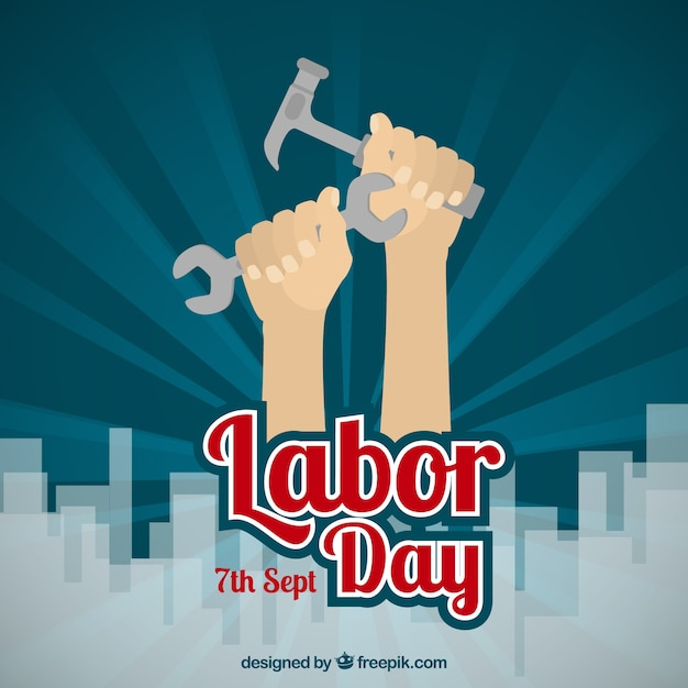Labor day background with hands holding\ tools