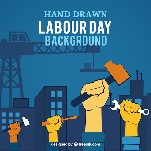 Labour day background of raised hands with tools