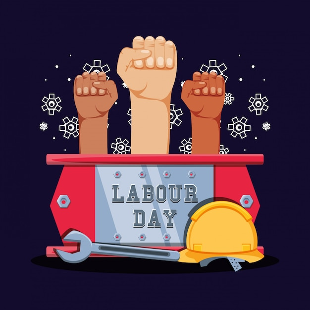Labour day celebration with hands fist and tools Premium Vector