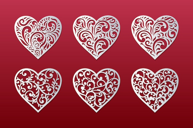 Laser cut hearts set with lace floral hearts design Premium Vector