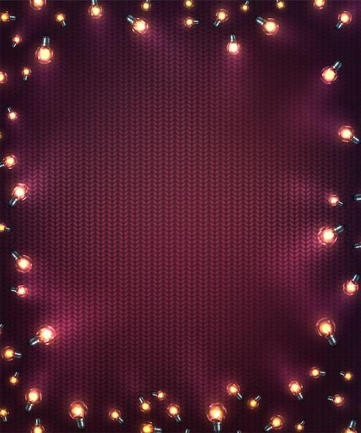 クリスマスライトとクリスマスの背景。ニットテクスチャ上のled電球の休日輝く花輪 Premiumベクター