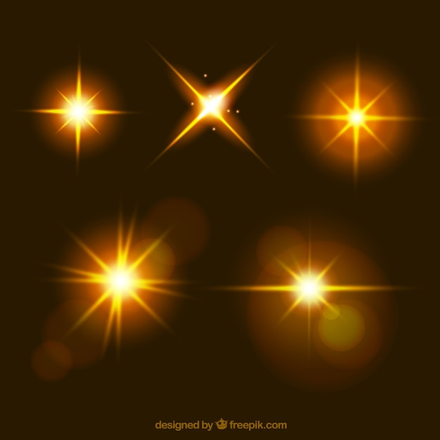 Lens flare collection in golden color Free Vector
