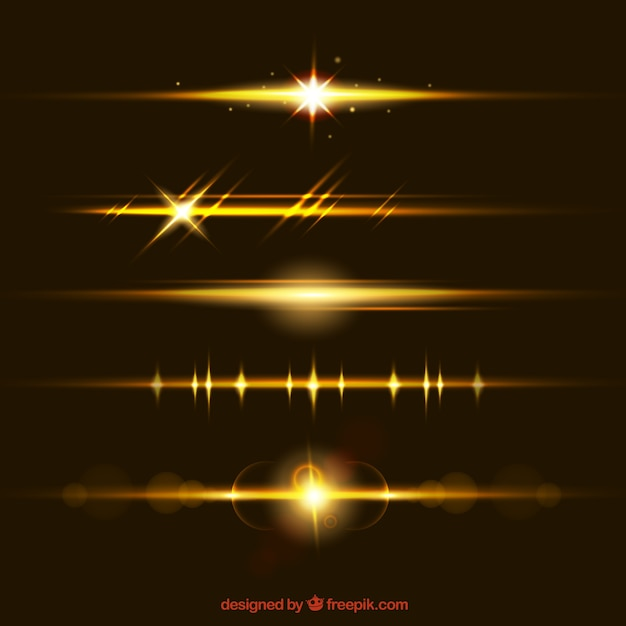 Lens flare dividers collection in golden color Free Vector