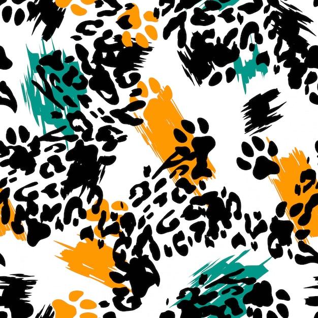 Leopard print animal seamless pattern. Premium Vector