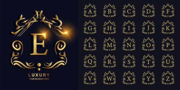 文字eまたは豪華な飾り花フレームゴールデンロゴテンプレートとコレクションの最初のアルファベット。 Premiumベクター