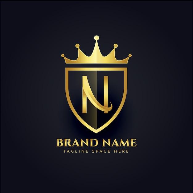 Буква n корона золотой премиум дизайн логотипа Бесплатные векторы