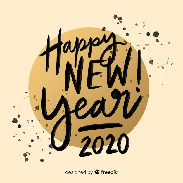 Lettering happy new year 2020 in ink Free Vector