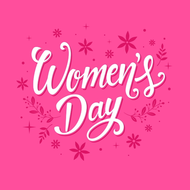 Lettering women's day with flowers Free Vector