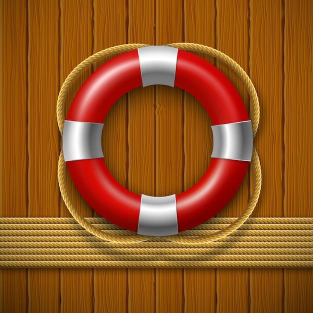 Спасательный круг на деревянной стене Premium векторы
