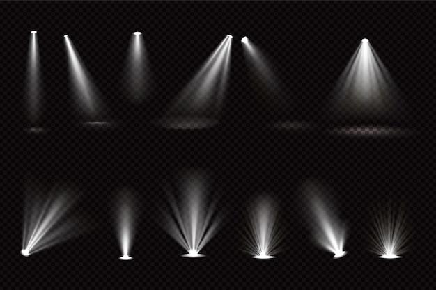 Световые лучи от прожекторов и напольных прожекторов изолированы Бесплатные векторы