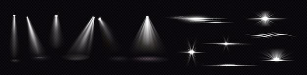 Fasci di luce da faretti e lampi isolati su sfondo trasparente. insieme realistico di effetti flare, raggi bianchi luminosi e riflessi con scintille. bagliori e bagliori del proiettore Vettore gratuito