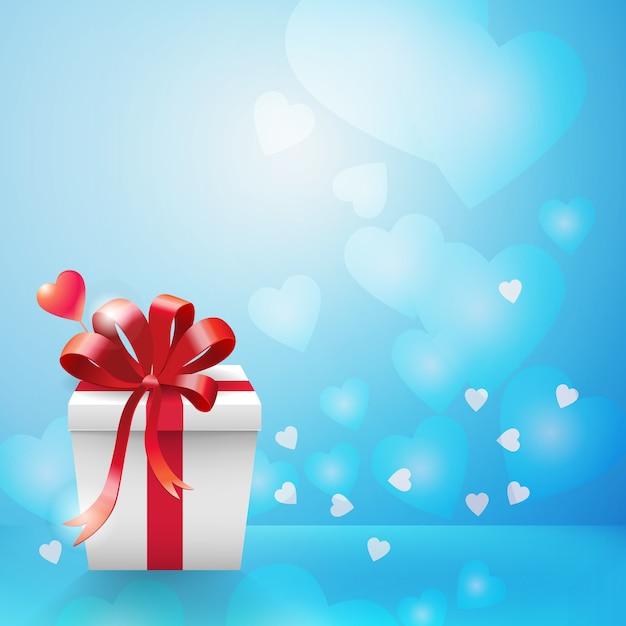 Голубой фон боке и сердца с вертикальной белой подарочной коробкой из картона и бантом из красной ленты в угловой квартире Бесплатные векторы
