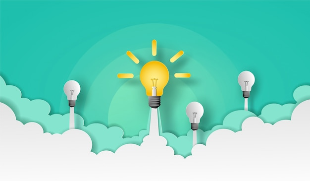 Light bulb and team launch to the green sky over the cloud and smoke. vector design in paper cut. Premium Vector
