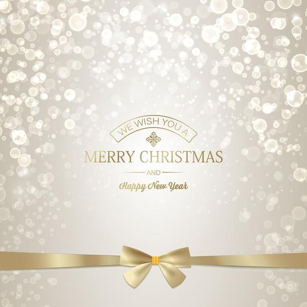 Luce felice anno nuovo e cartolina d'auguri di natale con iscrizione dorata e fiocco in nastro Vettore gratuito
