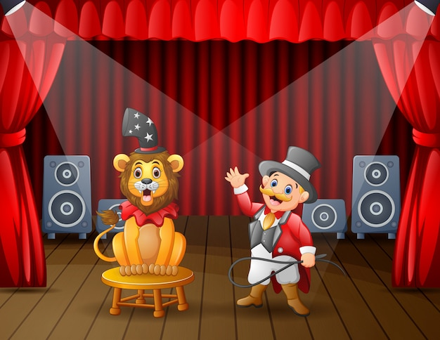A lion circus with trainer performing on the stage Premium Vector