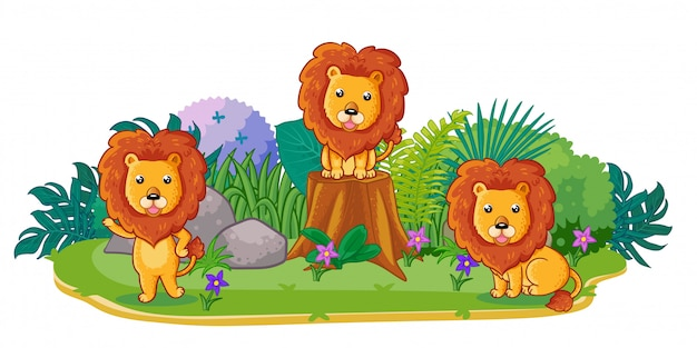 Lions are playing together in the garden Premium Vector
