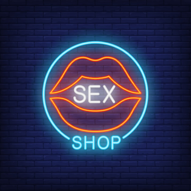 Lips with sex shop lettering in circle. neon sign on brick background. Free Vector
