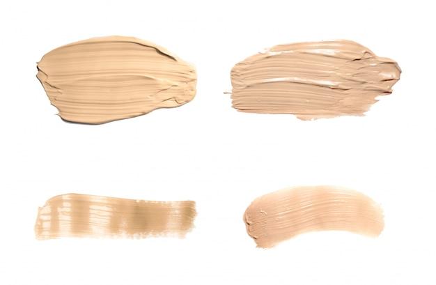 Liquid foundation tone smudge. set concealer smear cosmetic cream isolated Premium Vector