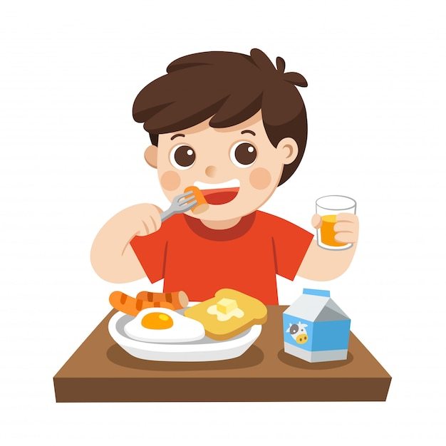 A little boy happy to eat breakfast in the morning. isolated Premium Vector