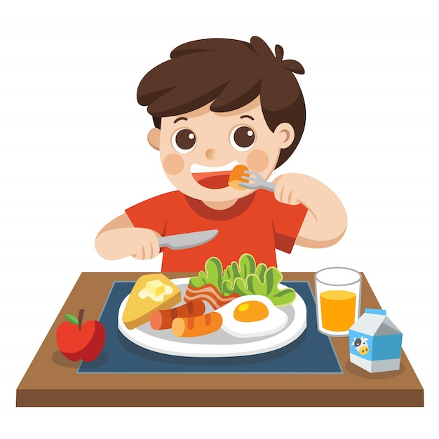 A little boy happy to eat breakfast in the morning. Premium Vector