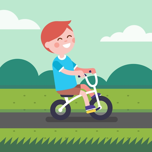 Little boy kid riding bicycle on a park bike\ path