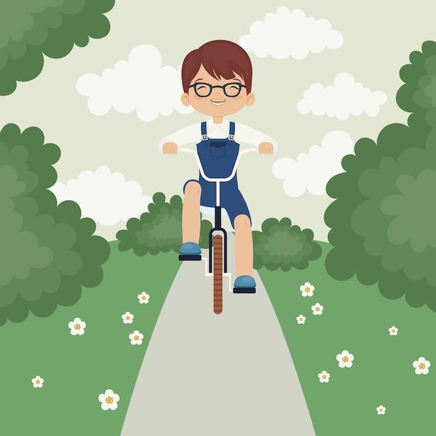 Little boy riding a bike Premium Vector