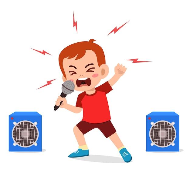 小さな男の子がステージで歌を歌い、叫びます Premiumベクター