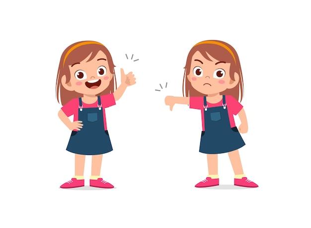 小さな女の子は手のジェスチャーの親指を上に、親指を下に表示 Premiumベクター