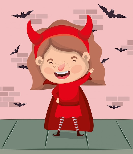 Little girl with devil costume and bats flying in wall Premium Vector