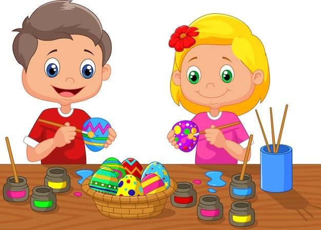 Premium Vector   Little kids painting easter egg