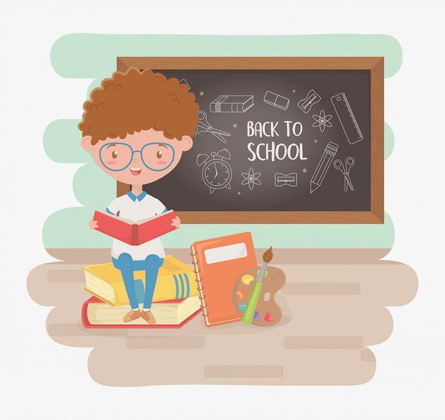 Little student boy with chalkboard and school supplies Free Vector