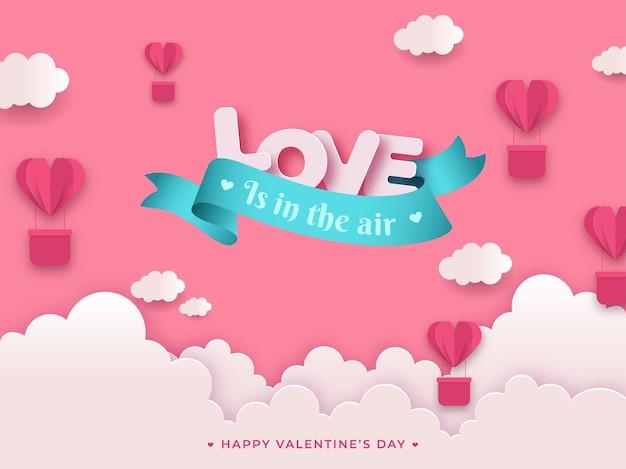 Любовь в воздухе текст сообщения с вырезанными из бумаги воздушными шарами в форме сердца и облаками на розовом фоне на день святого валентина. Premium векторы