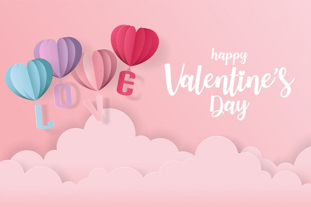 Love and valentine day card with heart balloon, gift and clouds. paper cut style Premium Vector
