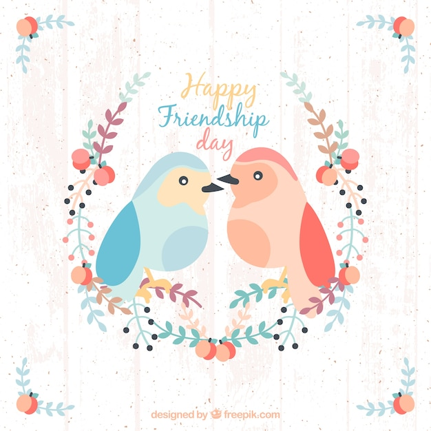 Lovely birds with floral details friendship background Free Vector
