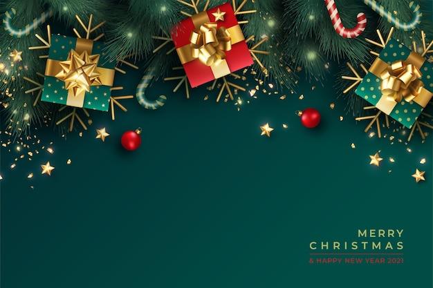 Прекрасный новогодний фон с реалистичным зеленым и красным украшением Бесплатные векторы