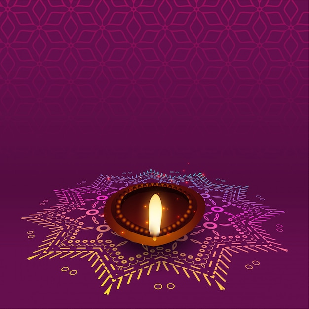 Lovely diwali diya with rangoli design Free Vector