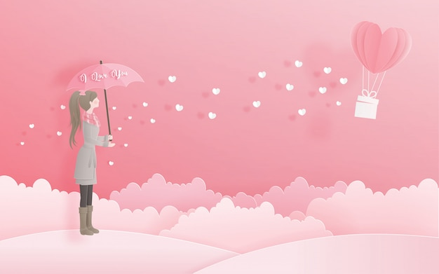 Lovely girl holding an umbrella looking at heart balloon, valentine's day and card Premium Vector