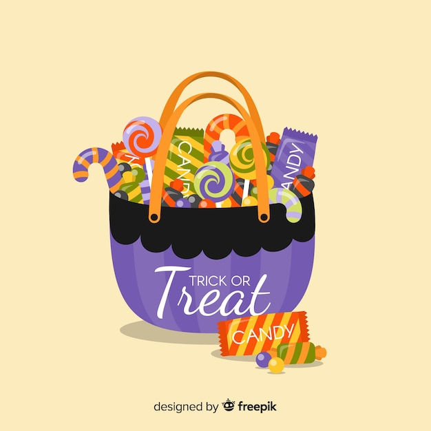 Lovely halloween candy bag with flat design Free Vector