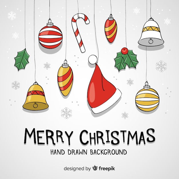 Lovely hand drawn christmas background Free Vector