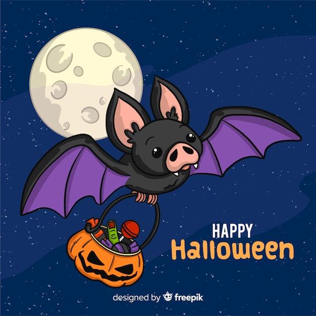 Lovely hand drawn halloween bat Free Vector