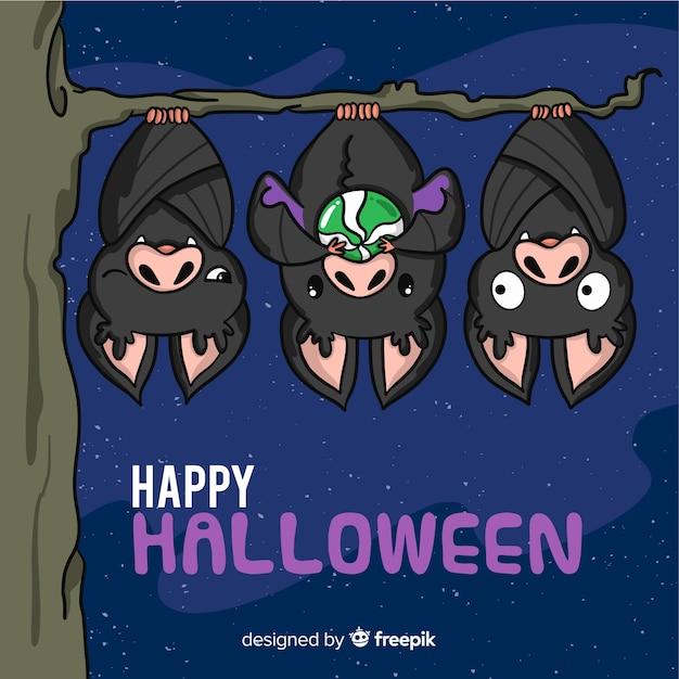 Lovely hand drawn halloween bats Free Vector